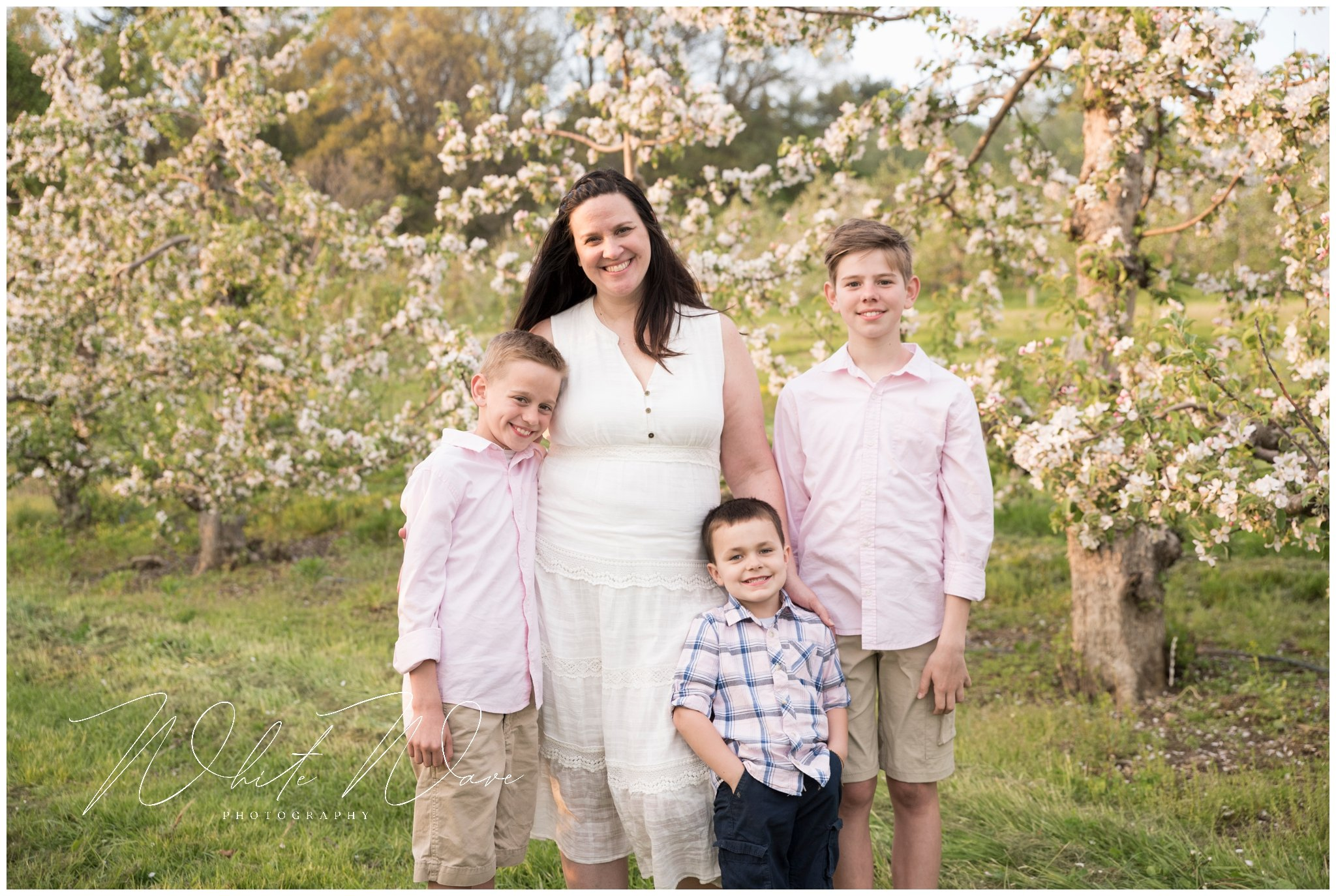 mom with her boys during her outdoor spring photography session
