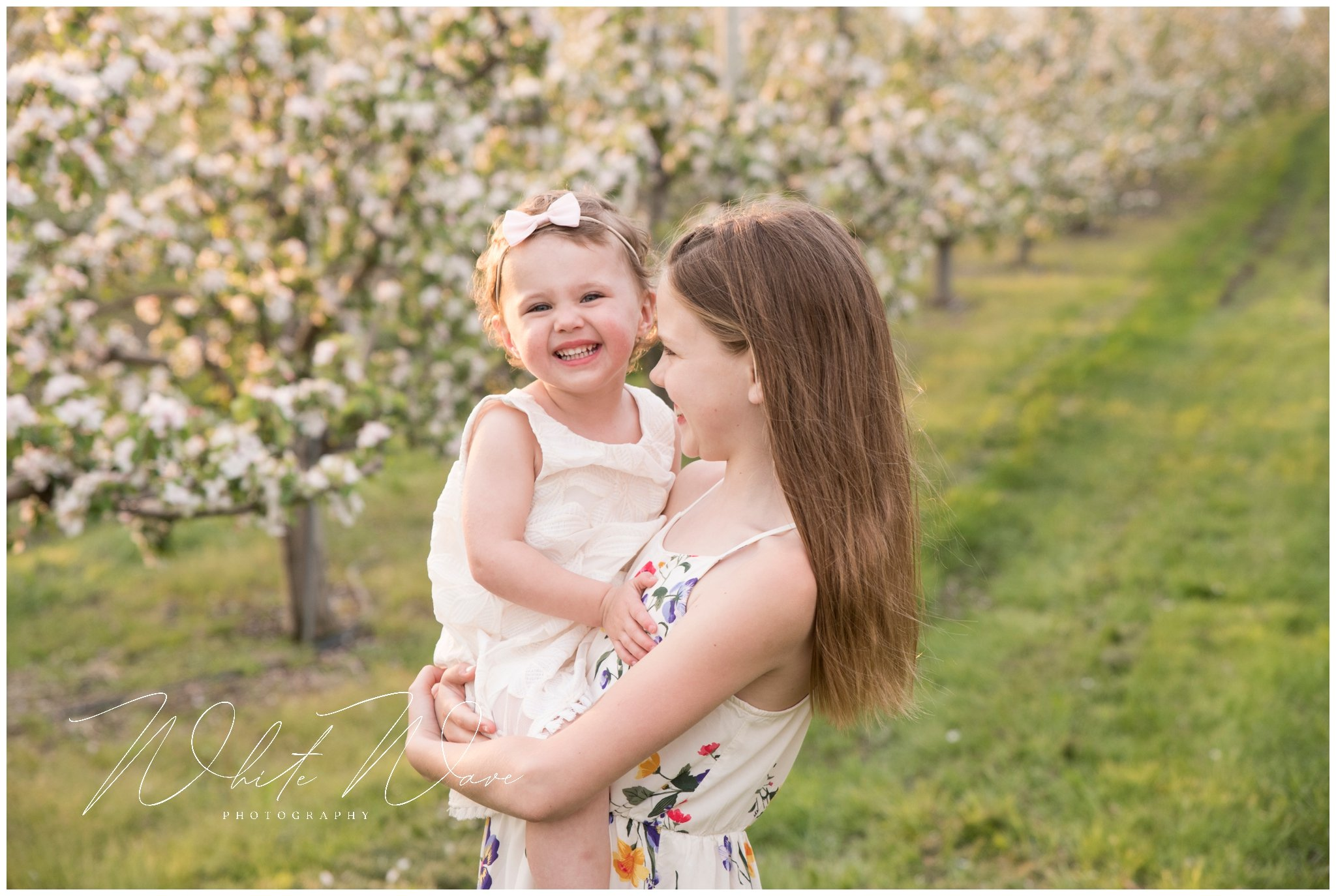 sweet sisters during this outdoor spring family portrait session